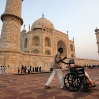 divyang jan : a wheelchair user at Taj Mahal in India