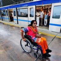 A woman wheelchair user at a Delhi Metro station.
