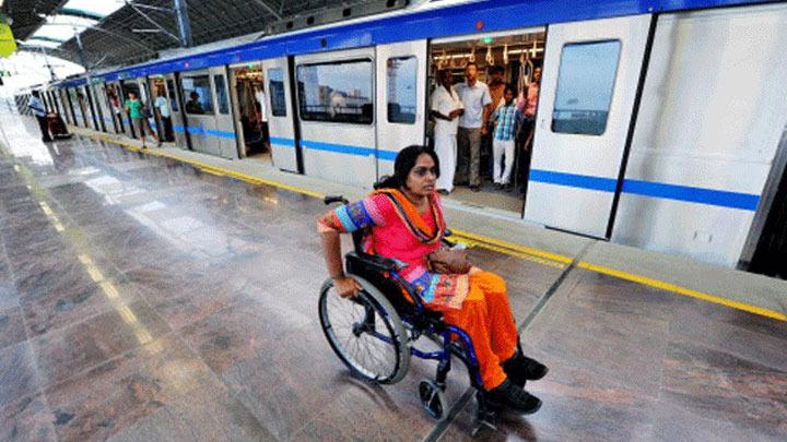 A woman wheelchair user at a Delhi Metro station.