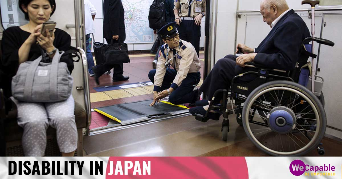 a person in wheelchair getting off a train in Japan as a railway employee sets up ramp for him.
