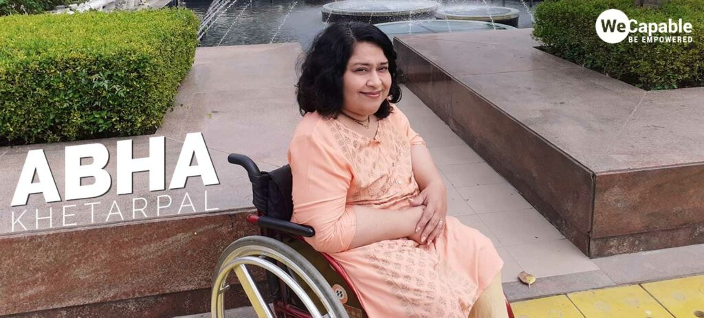 Abha Khetarpal sitting in her wheelchair at a public place