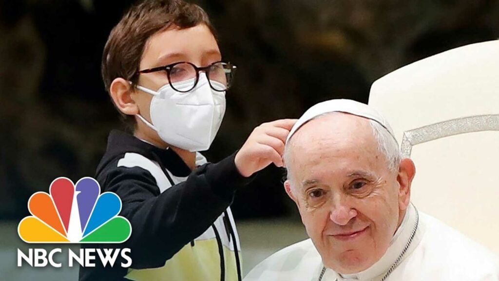 Pope Francis and Paolo Jr. , a mentally challenged boy.
